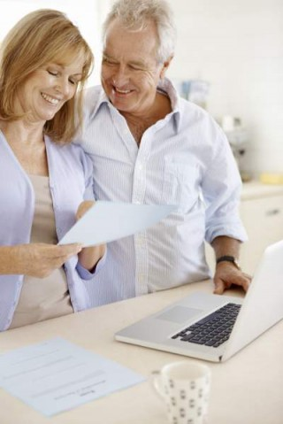 Happy couple reviewing financial statements